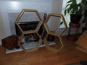 honeycomb shelves on fireplace