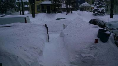 Do you see top of the car buried in mound of the snow?