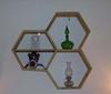 honeycomb shelves on wall